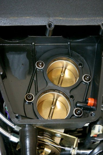 detail photograph of a victory motorcycle throttle body