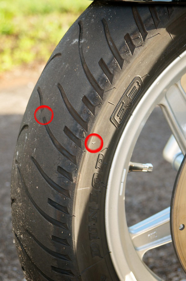 Side View Of Worn Dunlop Motorcycle Tire Showing Wear Bar Location