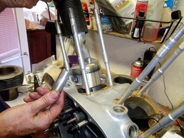vincent rapide engine pistons during assembly
