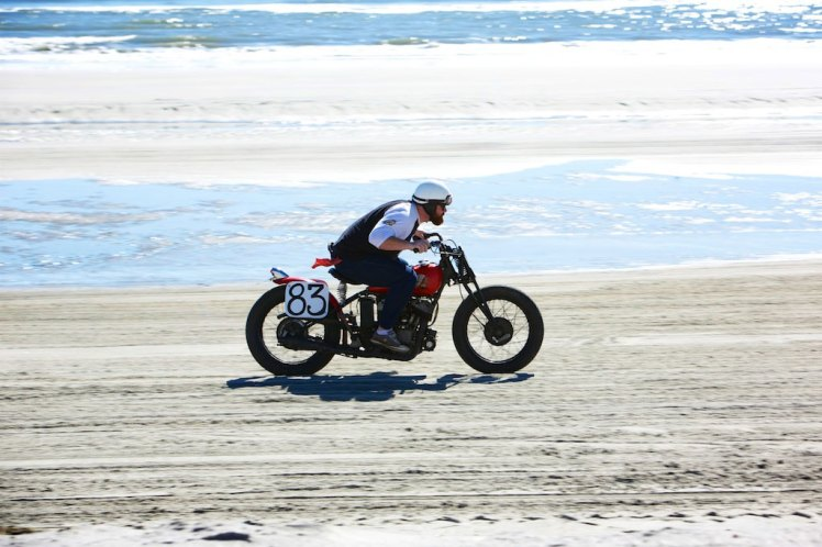 1941 indian scout racing on the beach in new jersey at the gentleman's race in wildwood, new jersey